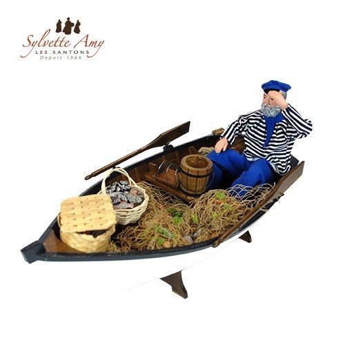 Le pêcheur dans sa barque