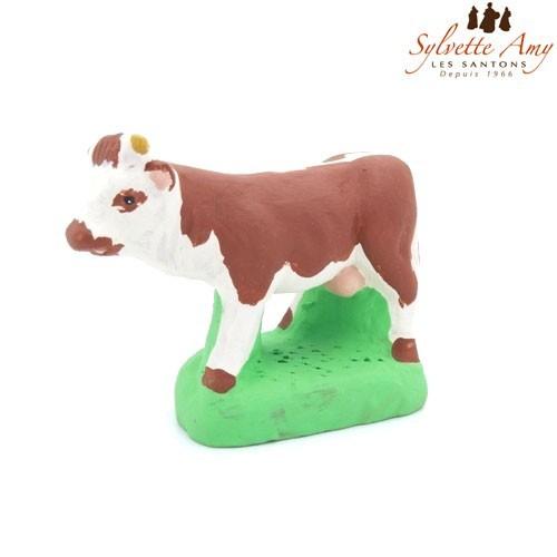 La vache marron et blanche